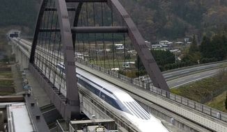 A test model maglev train runs on a test track in Tsuru, west of Tokyo, Nov. 26, 2012. The train gets its name from the way it uses an electromagnetic cushion instead of wheels for levitation and propulsion. (Associated Press)