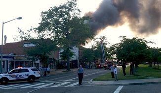 A three-alarm fire burns Frager's Hardware store on Capitol Hill on June 5. (Meredith Somers/The Washington Times)