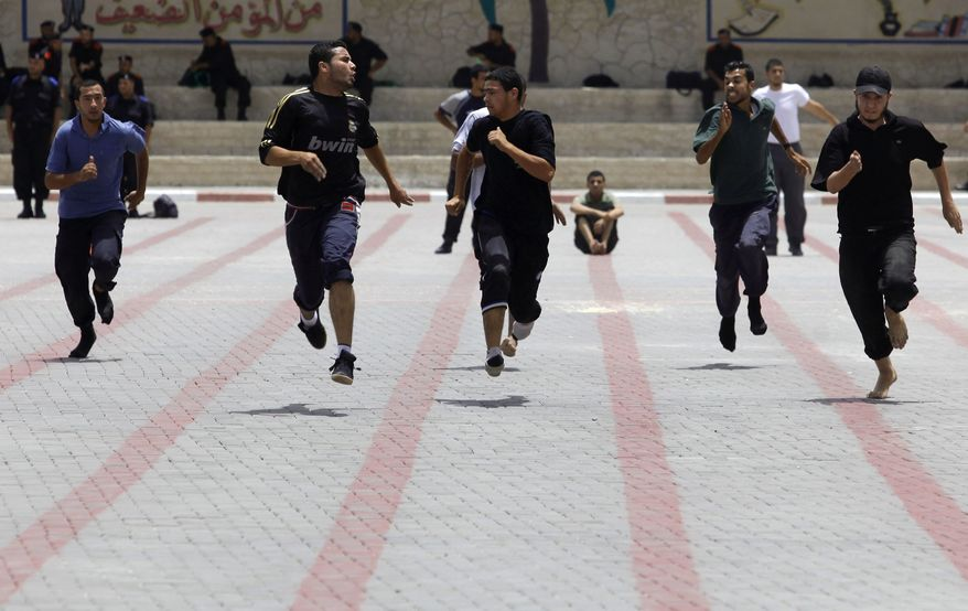 Palestinian applicants to the Hamas police force take part in a fitness test at a Hamas recruitment center in Gaza City, Monday, June 3, 2013. Hamas interior ministry said they will choose 100 applicants from 14,000 applicants aged between 18 to 25 to join the security forces loyal to Hamas. (AP Photo/Hatem Moussa)
