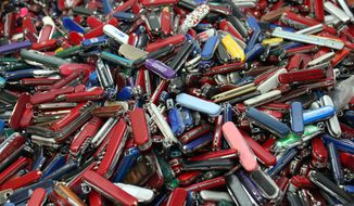 **FILE** Knives of all sizes and types are piled in a box at the State of Georgia Surplus Property Division store in Tucker, Ga., on Sept. 26, 2006, and are just a few of the hundreds of items discarded at the security checkpoints of Hartsfield-Jackson Atlanta International Airport that will be for sale at the store. (Associated Press)