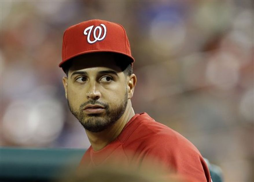 Washington Nationals starting pitcher Gio Gonzalez sits on the bench during a baseball game against the New York Mets at Nationals Park Tuesday, June 4, 2013, in Washington. The Nationals won 3-2. (AP Photo/Alex Brandon)