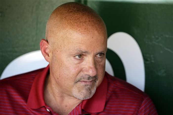 Washington Nationals general manager Mike Rizzo pauses while speaking during a media availability before a baseball game against the New York Mets Tuesday, June 4, 2013, in Washington. The Nationals made several roster changes Tuesday. (AP Photo/Alex Brandon)