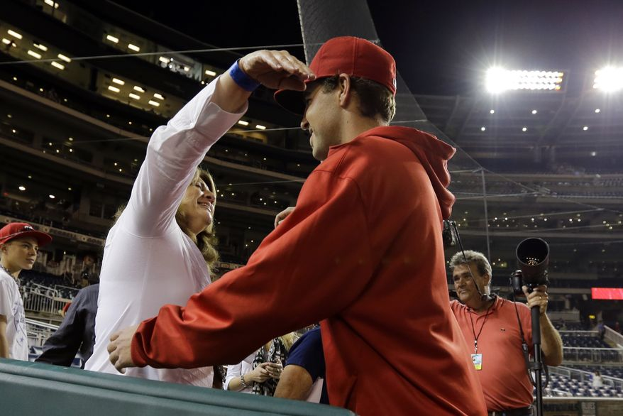 Tambra Kams, left, from Arlington, Texas, hugs her son Washington Nationals starting pitcher Nathan Karns, after his first major league start, after an interleague baseball game against the Baltimore Orioles at Nationals Park Tuesday, May 28, 2013, in Washington. The Nationals won 9-3. (AP Photo/Alex Brandon)