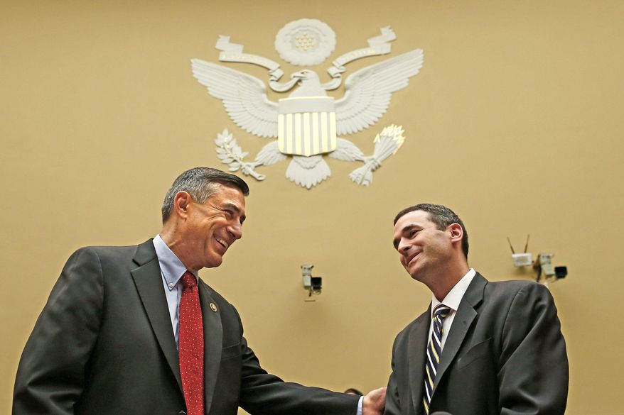 Acting IRS Commissioner Danny Werfel (right) talks with House Oversight and Government Reform Committee Chairman Rep. Darrell E. Issa, California Republican, prior to testifying before the committee on Thursday. (Associated Press)