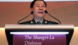 Lt. Gen. Qi Jianguo, deputy chief of staff for the Chinese army, delivered an about-face to an international conference claiming China recognizes that the Ryukyu island chain belongs to Japan after all. (Associated Press)