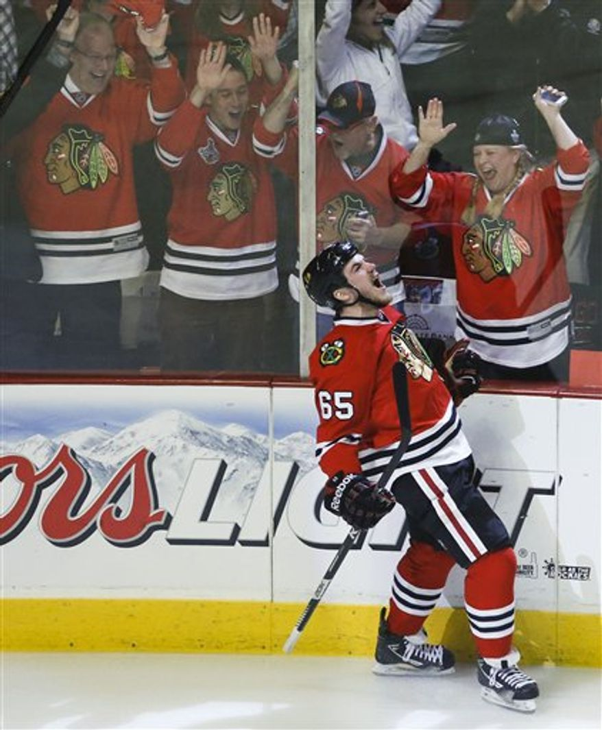 Chicago Blackhawks center Andrew Shaw (65) reacts after scoring a goal against the Los Angeles Kings during the first period in Game 2 of the NHL hockey Stanley Cup Western Conference finals Sunday, June 2, 2013 in Chicago. (AP Photo/Charles Rex Arbogast)