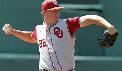 FILE - In this June 3, 2012 file photo, Oklahoma pitcher Jonathan Gray (22) throws a pitch during an NCAA college baseball regional game against Army in Charlottesville, Va. (AP Photo/Andrew Shurtleff, File)