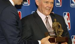 Denver Nuggets head coach George Karl, right, smiles as he is presented with the Red Auerbach trophy by team president Josh Kroenke after Karl was named the NBA Coach of the Year at a news conference in Denver on Wednesday, May 8, 2013. (AP Photo/David Zalubowski)