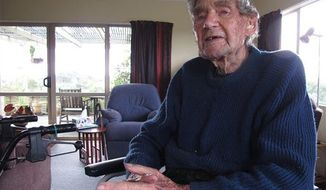 New Zealand's oldest driver Bob Edwards sits in his home as he reminisces about his life in Ngataki, New Zealand, May 26, 2013.. Edwards, 105-year-old, got his first license 88 years ago and has no plans to stop driving.