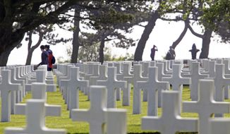 ** FILE ** Visitors walk among the graves at the Normandy American Cemetery overlooking Omaha Beach in Colleville-sur-Mer, France, on Thursday, June 6, 2013, the 69th anniversary of D-Day. (AP Photo/Remy de la Mauviniere)