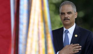 Attorney General Eric Holder attends the 50th anniversary remembrance ceremony for slain civil rights activist Medgar Evers, Wednesday, June 5, 2013, at Arlington National Cemetery in Arlington, Va. (AP Photo/Susan Walsh)