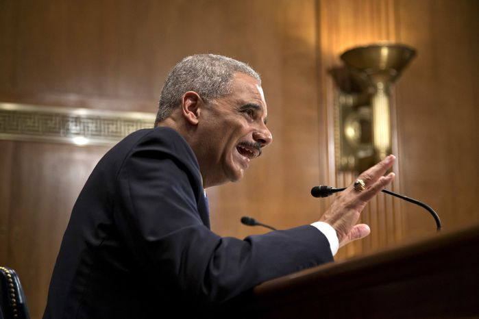 Attorney General Eric Holder testifies on Capitol Hill in Washington, Thursday, June 6, 2013, before a Senate Appropriations subcommittee as lawmakers examine the budget for the Justice Department. (AP Photo/J. Scott Applewhite)