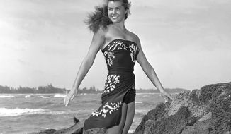 "MGM swimming star Esther Williams poses on location for the film ""Pagan Love Song"" in May 1950. Miss Williams died in her sleep on Thursday, June 6, 2013, in Beverly Hills, Calif., at age 91, her publicist said. (AP Photo/Metro-Goldwyn-Mayer)"
