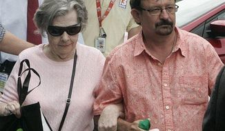 Powerball winner Gloria C. Mackenzie, 84, left, leaves the lottery office escorted by her son, Scott Mackenzie, after claiming a single lump-sum payment of about $370.9 million before taxes on Wednesday, June 5, 2013, in Tallahassee, Fla. Officials say she is the largest sole lottery winner in U.S. history. (Associated Press)