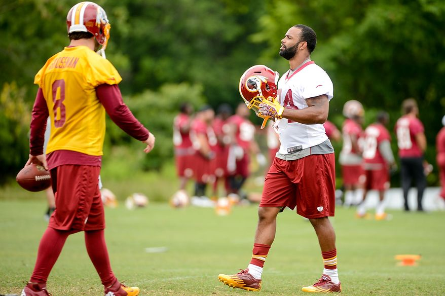 Washington Redskins tight end Niles Paul (84), right, during a NFL football organized team activity at Redskins Park, Ashburn, Va., Thursday, June 6, 2013. (Andrew Harnik/The Washington Times)
