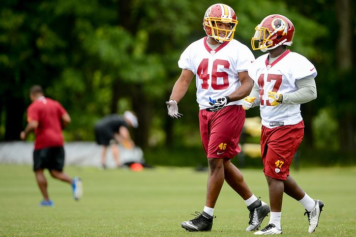 Washington Redskins running back Alfred Morris (46), center, talks with running back Jawan Jamison, right, during a NFL football organized team activity at Redskins