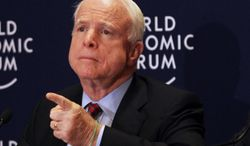 **FILE** Sen. John McCain, Arizona Republican, speaks May 25, 2013, at a news conference at the World Economic Forum, in Southern Shuneh, southeast of Amman, Jordan. (Associated Press)