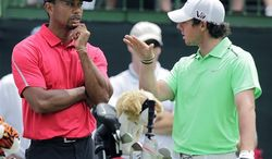 FILE - In this June 2, 2013, file photo, Tiger Woods, left, talks with Rory McIlroy, of Northern Ireland, as they wait to hit on the 12th hole during the final round of the Memorial golf tournament in Dublin, Ohio. Few other American courses have the kind of history found at Merion. They have red wicker baskets, the symbol of golf club, though its origins remain a mystery. Equally mysterious to Woods, McIlroy and the rest of the stars at the 113th U.S. Open is Merion itself. (AP Photo/Jay LaPrete)