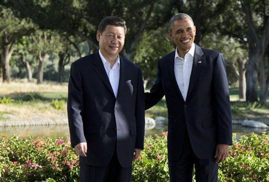 President Obama poses with Chinese President Xi Jinping at the Annenberg Retreat at Sunnylands as they meet for talks Friday, June 7, 2013, in Rancho Mirage, Calif. (AP Photo/Evan Vucci)
