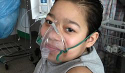 This undated photo provided by Blair Kahora Cardinal shows Javier Acosta, 11, of New York, who has cystic fibrosis and is in intensive care at Children's Hospital of Philadelphia, the same hospital where 10-year-old Sarah Murnaghan is a patient. (AP Photo/Blair Kahora Cardinal, Milagros Martinez)
