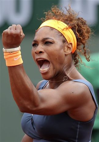 Serena Williams, of the U.S, celebrates a winning point as she plays Russia's Maria Sharapova during the Women's final match of the French Open tennis tournament at the Roland Garros stadium Saturday, June 8, 2013 in Paris. (AP Photo/Michel Euler)