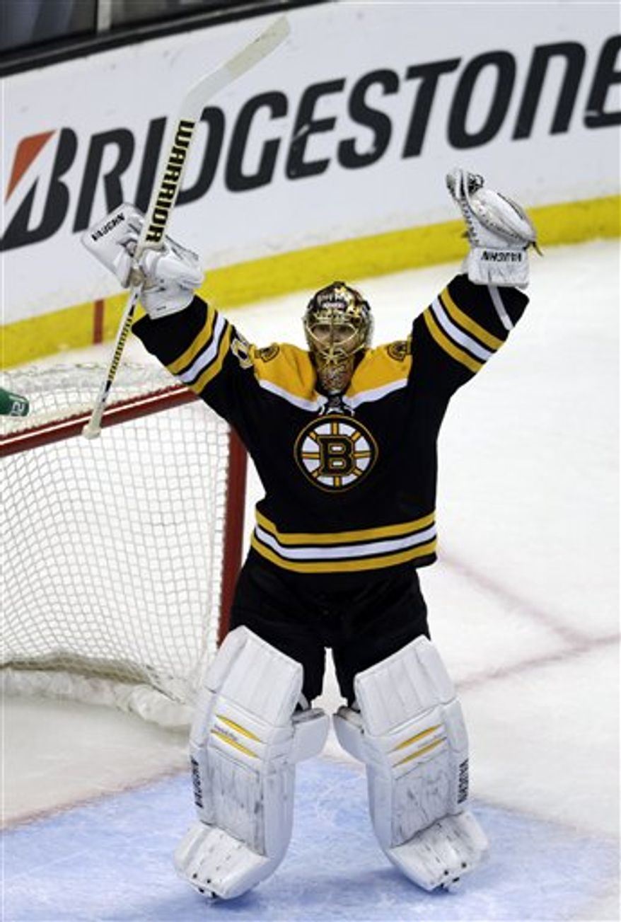 Boston Bruins goalie Tuukka Rask (40) celebrates after the Bruins won Game 4 of the Eastern Conference finals of the NHL hockey Stanley Cup playoffs against the Pittsburgh Penguins in Boston, Friday, June 7, 2013. The Bruins won 1-0 to advance to the Stanley Cup finals. (AP Photo/Charles Krupa)