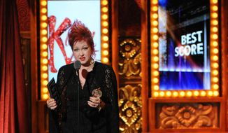 "Cyndi Lauper accepts the Tony Award for best score for her work on the music and lyrics for ""Kinky Boots,"" at the 67th annual Tony Awards on Sunday, June 9, 2013, in New York. (Evan Agostini/Invision/AP)"