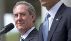 Michael Froman (left), President Obama's pick to be the nation's top trade negotiator, has said he has about $500,000 in Cayman Islands bank accounts. (Associated Press)