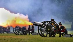 The King's Troop Royal Horse Artillery fires a 41-round Royal Salute in Green Park in central London on Monday, June 10, 2013, to mark Prince Philip's 92nd birthday. (AP Photo/Anthony Devlin, Press Association)