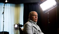 ** FILE ** Actor John Malkovich speaks with media at the King Edward Hotel in Toronto to promote his new role as Casanova in The Giacomo Variations, on Thursday, June 6, 2013. (AP Photo/The Canadian Press, Galit Rodan)