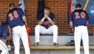 Virginia's Jared King,center, reacts next to teammates Mike Papi, left, and Brandon Waddell, right, after a 6-5 loss to Mississippi State in an NCAA super regional college baseball game in Charlottesville, Va., Monday, June 10, 2013. Mississippi State advances to the College World Series. (AP Photo/Andrew Shurtleff)