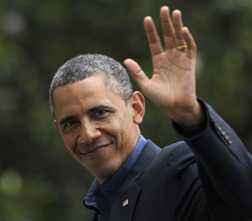 President Barack Obama waves as walks from Marine One to the White House on the South Lawn after returning to Washington, Sunday, June 9, 2013. Obama spent the weekend in California where he met with Chinese leader Xi Jinping. (AP Photo/Susan Walsh)