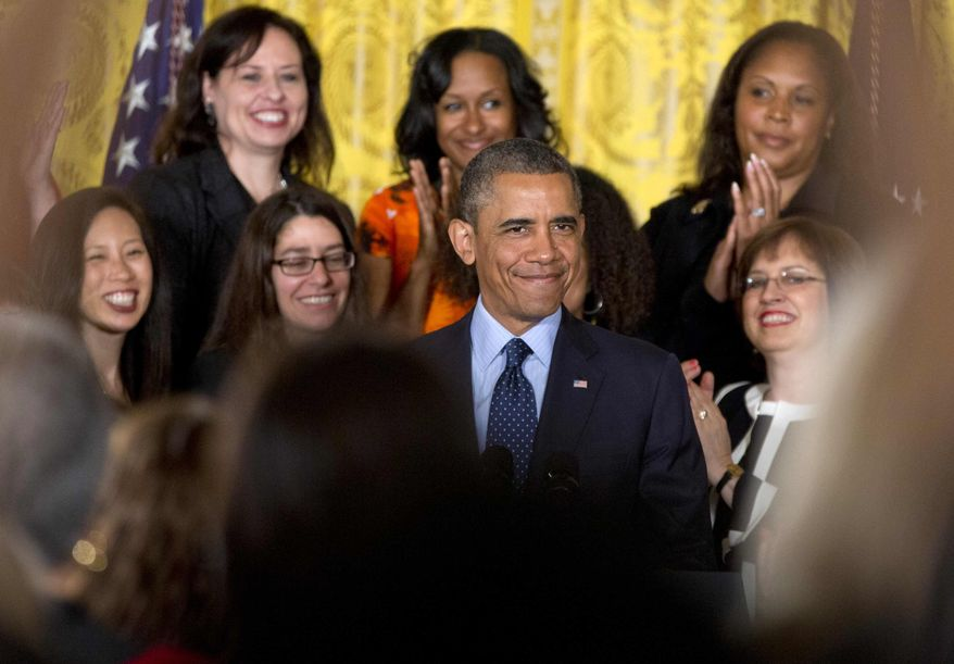 President Barack Obama is applauded as he arrives in the East Room of the White House in Washington, Monday, June 10, 2013, to speak during a ceremony to commemorate the 50th anniversary of the Equal Pay Act. Obama highlighted the gap in pay that still exists between men and women. (AP Photo/Carolyn Kaster)