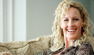 Environmental activist Erin Brockovich is pictured in her home in Agoura Hills, Calif., in 2000. (AP Photo/Damian Dovarganes)