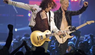 ** FILE ** Vivian Campbell (left) and Phil Collen of rock group Def Leppard perform in Las Vegas in 2006. (AP Photo/Jae C. Hong)