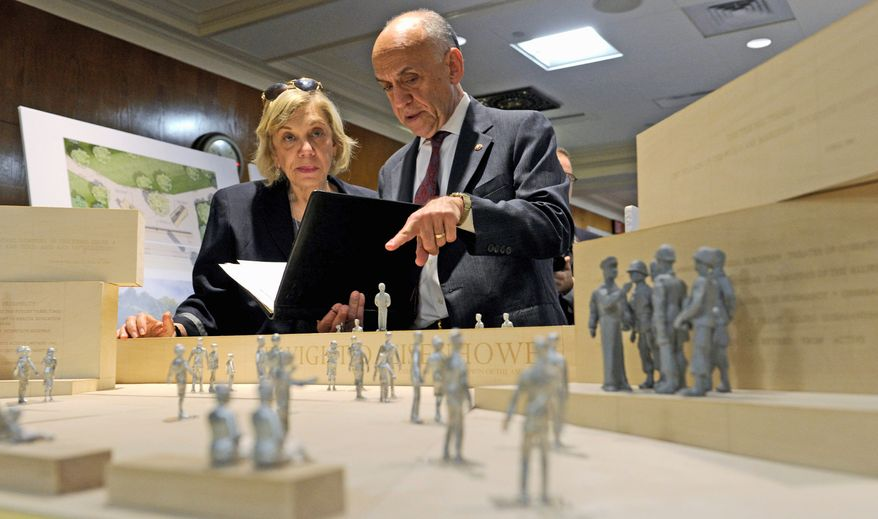 Daniel J. Feil, executive architect of the Eisenhower Memorial Commission, and Susan Banes Harris, who heads the commission's architecture committee, view architect Frank Gehry's model of the controversial Eisenhower Memorial. (Associated Press)