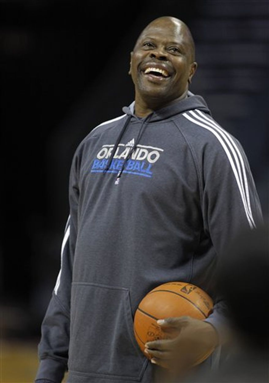 **FILE** FILE - In this March 6, 2012, file photo, Orlando Magic assistant coach Patrick Ewing laughs during a shoot around before an NBA basketball game against the Charlotte Bobcats in Charlotte, N.C. (AP Photo/Bob Leverone, File)