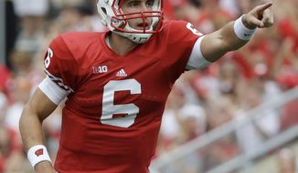 **FILE** Wisconsin quarterback Danny O'Brien celebrates after throwing a touchdown pass to Jared Abbrederis during the first half of an NCAA college football game against Northern Iowa Saturday, Sept. 1, 2012, in Madison, Wis. (AP Photo/Morry Gash)