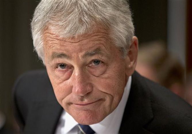Defense Secretary Chuck Hagel prepares to testify on Capitol Hill in Washington on Tuesday, June 11, 2013, before a Senate Defense subcommittee hearing to examine department leadership. (As