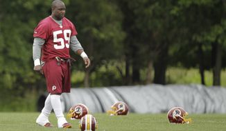 Washington Redskins linebacker London Fletcher (59) walks across the field during NFL football practice at Redskins Park, Thursday, June 6, 2013, in Ashburn, Va. (AP Photo/Luis M. Alvarez)