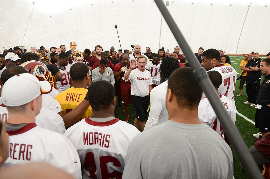 Washington Redskins head coach Mike Shanahan, center, talks to the team at the end of practice during mini camp at Redskins Park, Ashburn, Md., Tuesday, June 11, 2013. (Andrew Harnik/The Washington Times)