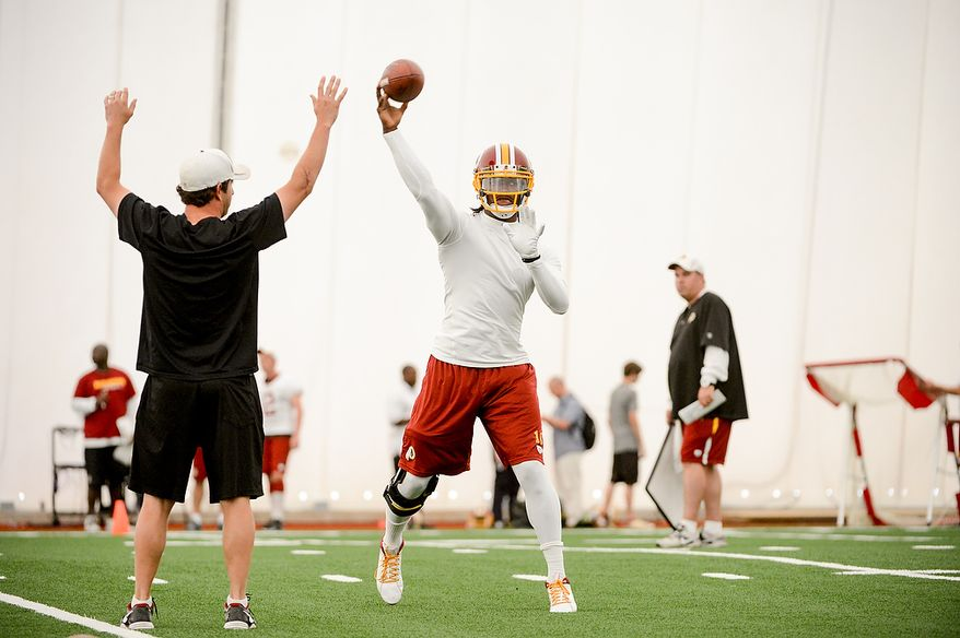 Washington Redskins quarterback Robert Griffin III (10) makes a pass during mini camp at Redskins Park, Ashburn, Md., Tuesday, June 11, 2013. (Andrew Harnik/The Washington Times)