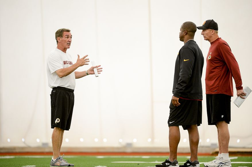 Left to right: Washington Redskins head coach Mike Shanahan talks with and defensive backs coach Raheem Morris and defensive coordinator Jim Haslett at mini camp at Redskins Park, Ashburn, Md., Tuesday, June 11, 2013. (Andrew Harnik/The Washington Times)