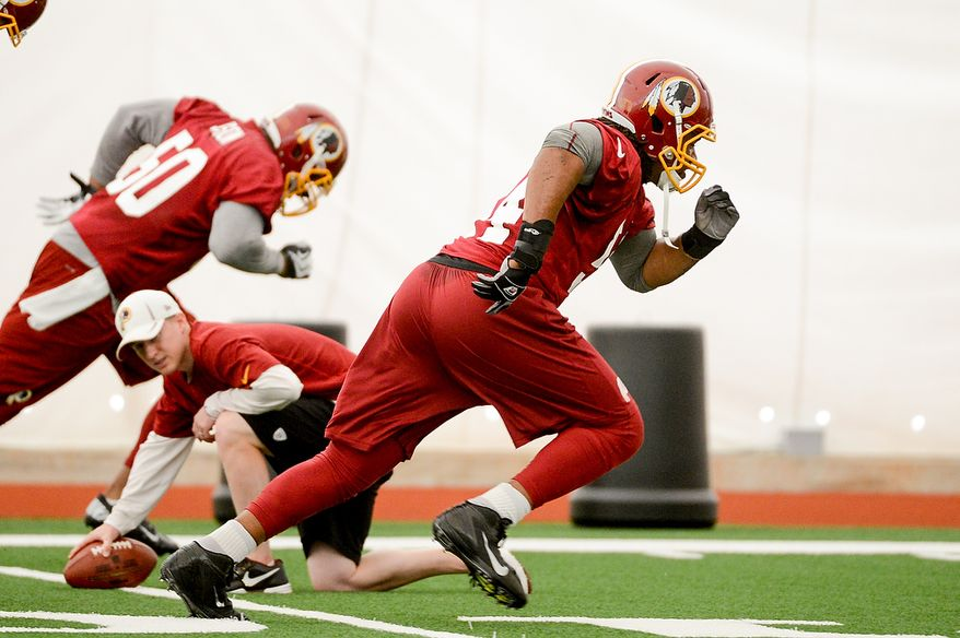 Washington Redskins linebacker Darryl Tapp (54), center, runs a drill during mini camp at Redskins Park, Ashburn, Md., Tuesday, June 11, 2013. (Andrew Harnik/The Washington Times)