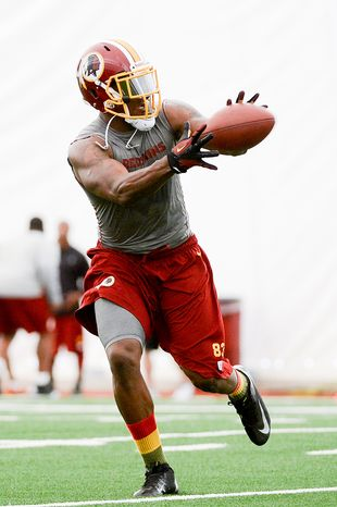 Washington Redskins tight end Fred Davis (83) makes a catch during mini camp at Redskins Park, Ashburn, Md., Tuesday, June 11, 2013. (Andrew Harnik/The Washington Times)