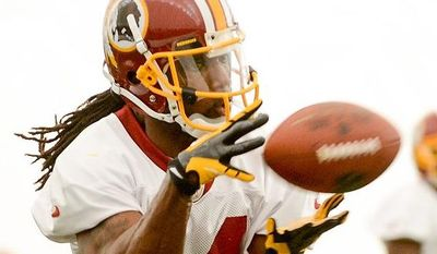 Wide receiver Donte Stallworth makes a catch while trying out for the Washington Redskins during mini camp at Redskins Park, Ashburn, Md., Tuesday, June 11, 2013. (Andrew Harnik/The Washington Times)