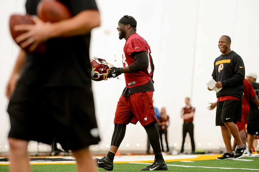 Washington Redskins outside linebacker Brian Orakpo (98), center, shares a laugh with teammates during mini camp at Redskins Park, Ashburn, Md., Tuesday, June 11, 2013. (Andrew Harnik/The Washington Times)