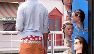 In this June 6, 2013 photo, a young man wears saggy pants on the Wildwood, N.J. boardwalk. Wildwood is set to pass a law regulating how people dress on its boardwalk, including a prohibition on pants that sag more than 3 inches below the hips, exposing either skin or underwear. (AP Photo/Wayne Parry)