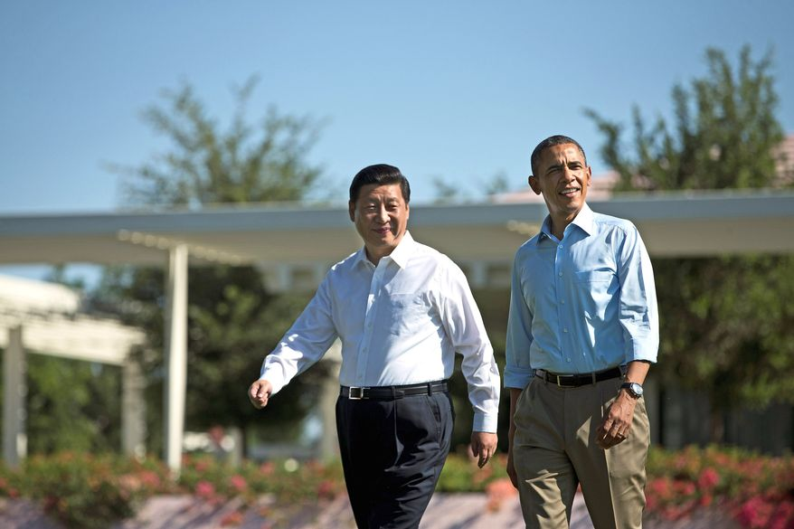 "President Barack Obama, right, walks with Chinese President Xi Jinping at the Annenberg Retreat at Sunnylands on Saturday, June 8, 2013, in Rancho Mirage, Calif. While saying it is critical that the U.S. and China reach a ""firm understanding"" on cyber issues, Obama told reporters his meetings with Xi have been ""terrific."" (AP Photo/Evan Vucci)"