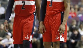 **FILE** Washington Wizards guards John Wall (2) and guard Bradley Beal (3) in the first half of an NBA basketball game against the Detroit Pistons Wednesday, Feb. 13, 2013, in Auburn Hills, Mich. (AP Photo/Duane Burleson)